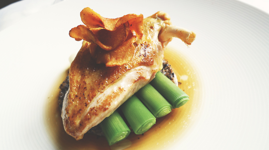 Roast guinea fowl with mushroom duxelle, leeks and parsnip crisp
