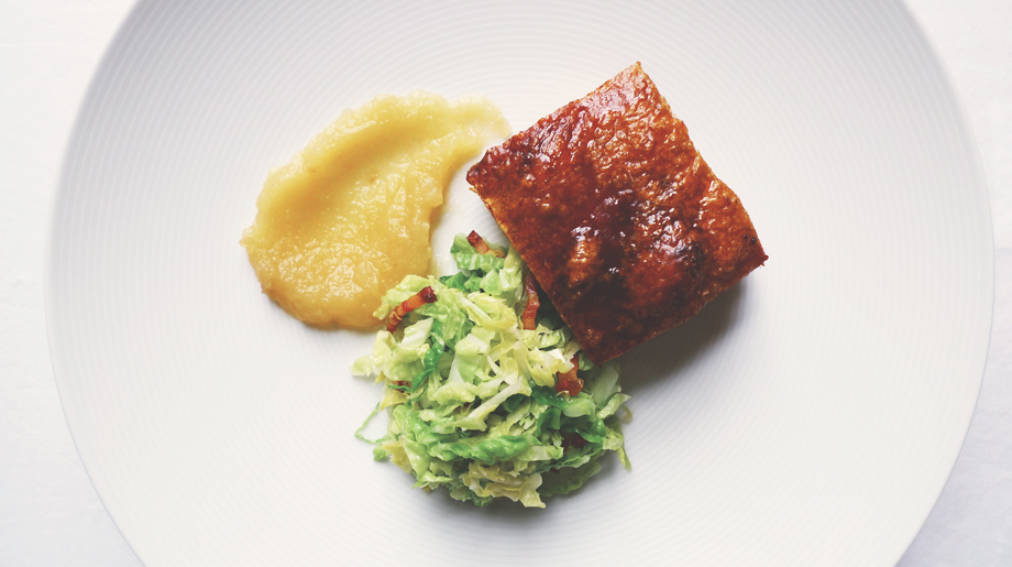 Slow roast pork belly with savoy cabbage and pancetta, apple puree