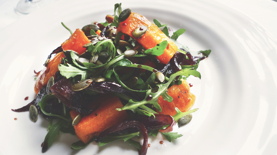 Roast squash, caramelised red onions and pumpkin seeds salad with balsamic dressing